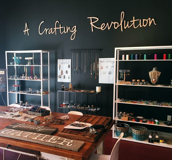 "Red Seal Studio space, wall art reads ""a crafting revolution"""