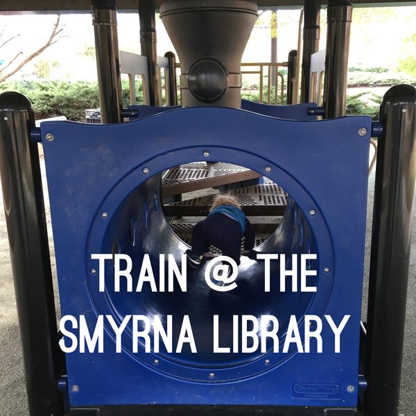 Toddler playing on the Train at the Smyrna Library