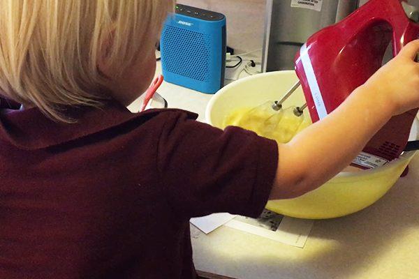 Toddler using the mixer