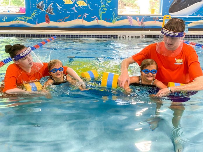 Goldfish Swim School instructors guide swimmers at their Roswell, GA location